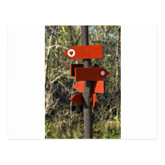 wooden direction sign postcard