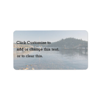Wooden docks and shallow water address label