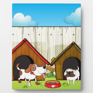 Wooden doghouses inside the wooden fence photo plaques