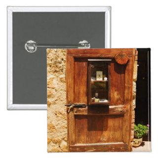 Wooden door of a house, Monteriggioni, Siena Button