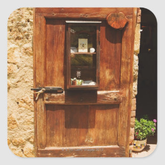 Wooden door of a house, Monteriggioni, Siena Square Sticker