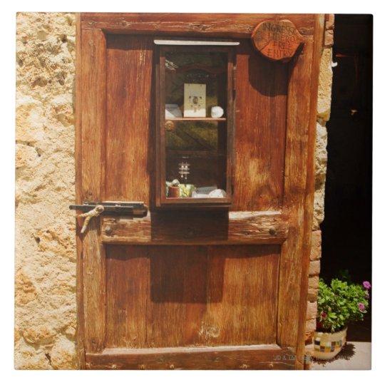 Wooden door of a house, Monteriggioni, Siena Tile