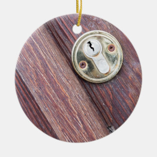 Wooden door with a keyhole brass ceramic ornament