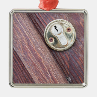 Wooden door with a keyhole brass metal ornament