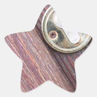Wooden door with a keyhole brass star sticker