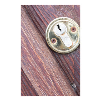 Wooden door with a keyhole brass stationery