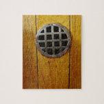 Wooden door with metal grill puzzle