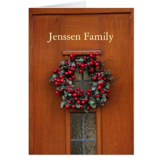 Wooden door with wreath address announcement