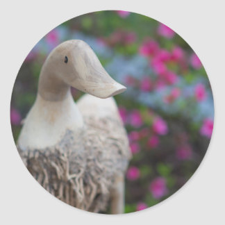 Wooden duck head with flowers classic round sticker