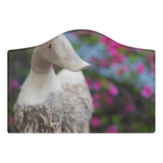 Wooden duck head with flowers door sign