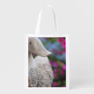 Wooden duck head with flowers grocery bag