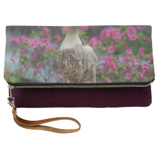 Wooden duck with flowers clutch