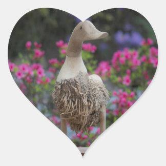 Wooden duck with flowers heart sticker