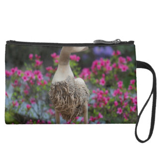 Wooden duck with flowers suede wristlet wallet