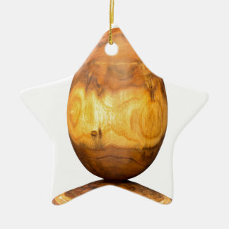 Wooden egg made of acacia tree with bark. ceramic ornament
