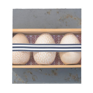 Wooden eggs in a box notepad