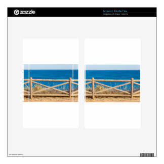 Wooden fence at coast with blue sea.JPG Skins For Kindle Fire