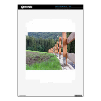 Wooden fence with forest in the background iPad 2 skins