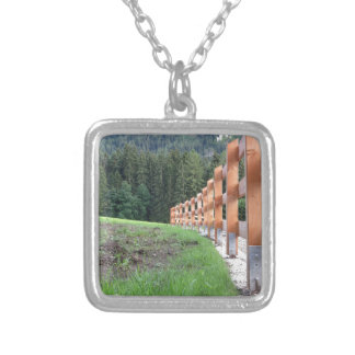 Wooden fence with forest in the background silver plated necklace