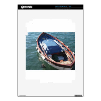 Wooden fishing boat anchored in a village port decal for iPad 2