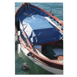 Wooden fishing boat anchored in a village port dry erase board