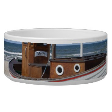Beach Themed Wooden fishing boat on the beach. bowl