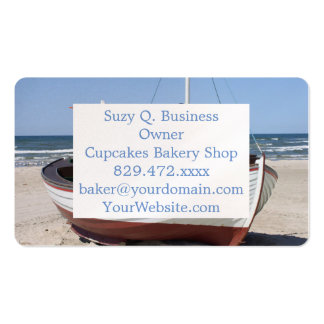 Wooden fishing boat on the beach. business card