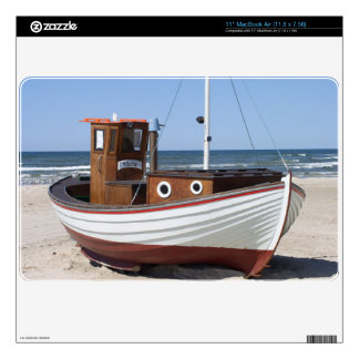 Wooden fishing boat on the beach. decal for the MacBook