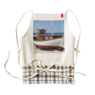 Wooden fishing boat on the beach. zazzle HEART apron