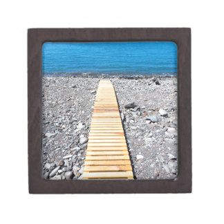Wooden footpath on beach leading to portuguese sea jewelry box