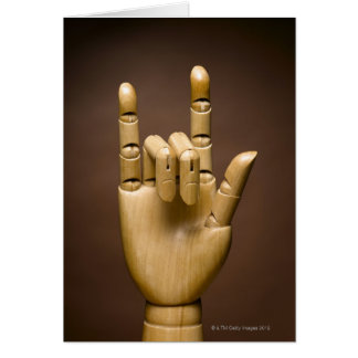 Wooden hand index and small finger extended, card