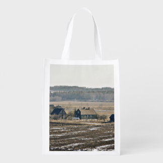 Wooden houses beside farms reusable grocery bag
