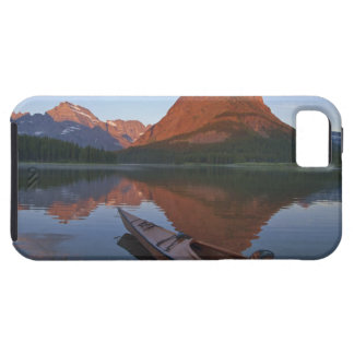 Wooden kayak in Swiftcurrent Lake at sunrise in iPhone 5 Cover
