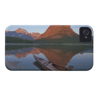 Wooden kayak in Swiftcurrent Lake at sunrise in iPhone 4 Cover