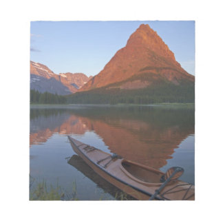 Wooden kayak in Swiftcurrent Lake at sunrise in Memo Pads