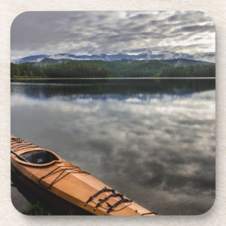 Wooden kayak on shore of Beaver Lake Coaster