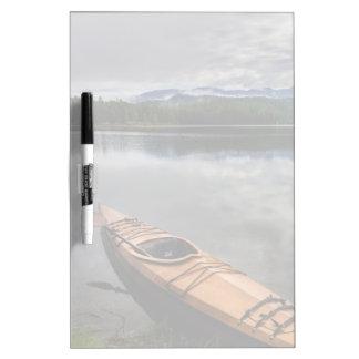 Wooden kayak on shore of Beaver Lake Dry Erase Board