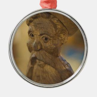 Wooden man metal ornament