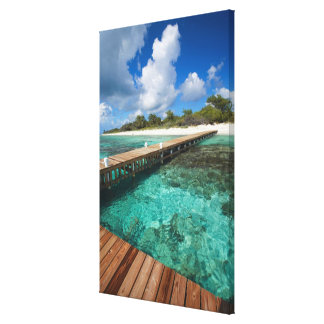 Wooden Pier Connecting to Beach Canvas Print