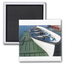 Wooden racing boat with four seats under repair magnet