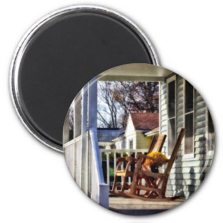 Wooden Rocking Chairs on Porch in Autumn 2 Inch Round Magnet