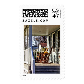 Wooden Rocking Chairs on Porch in Autumn Postage
