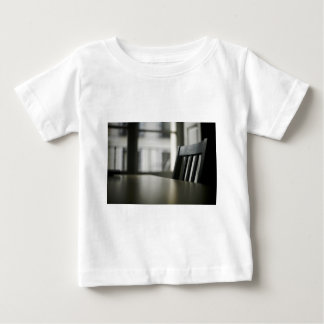 Wooden table desk and to chair in empty room baby T-Shirt