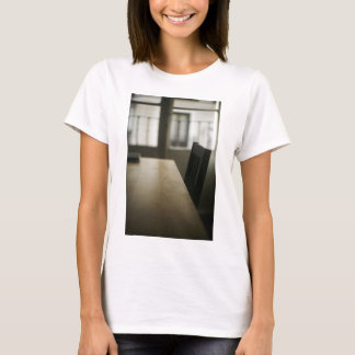 Wooden table desk and to chair in empty room with T-Shirt