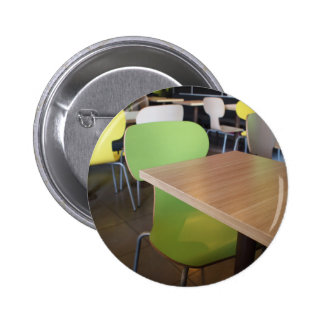 Wooden tables and chairs in a fastfood button