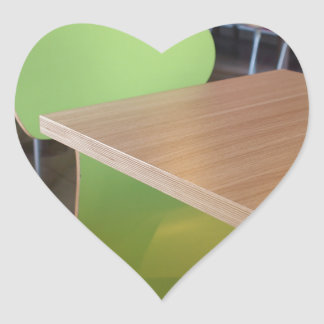 Wooden tables and chairs in a fastfood heart sticker
