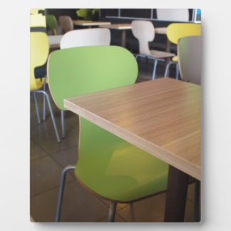 Wooden tables and chairs in a fastfood plaque