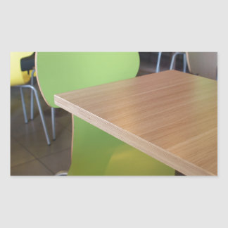 Wooden tables and chairs in a fastfood rectangular sticker