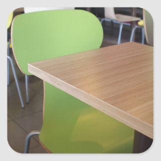 Wooden tables and chairs in a fastfood square sticker