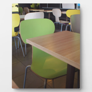 Wooden tables and chairs with furiture in restaura plaque